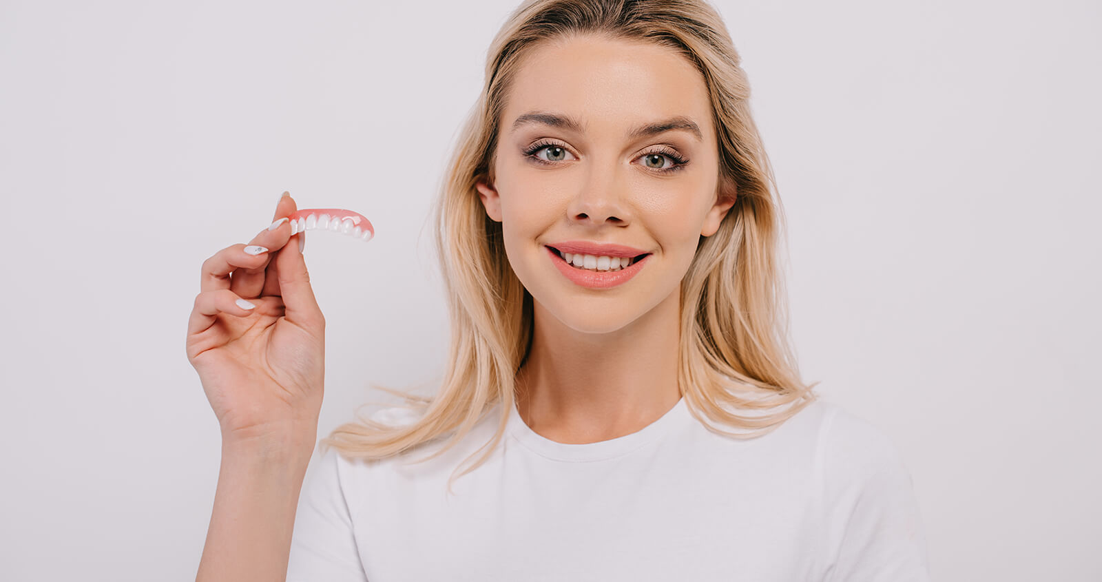 Natural-looking Dentures Made Available from Dentist in Highland, MI for Young People